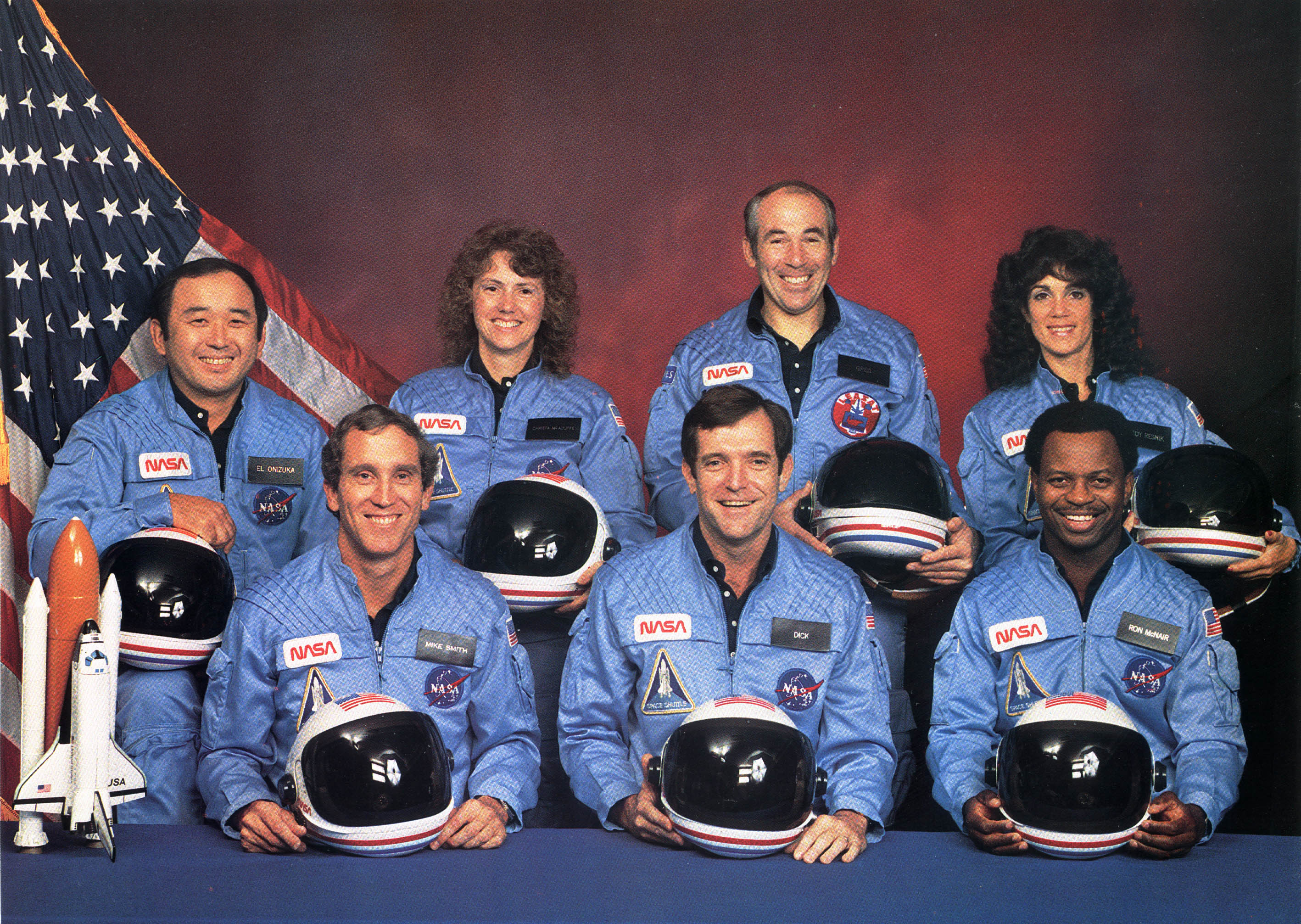 The Challenger Astronauts:  back row left to right El Onizuka, Christa McAuliffe, Greg Jarvis, Judy Resnik; front row left to right Mike Smith, Dick Scobee, and Ron McNair.
