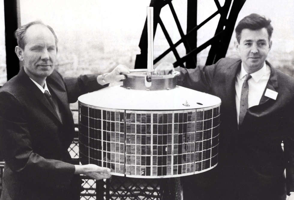 Thomas Hudspeth, left, Harold Rosen and Don Williams (not pictured) designed the electronics, propulsion and power system for a communications satellite.